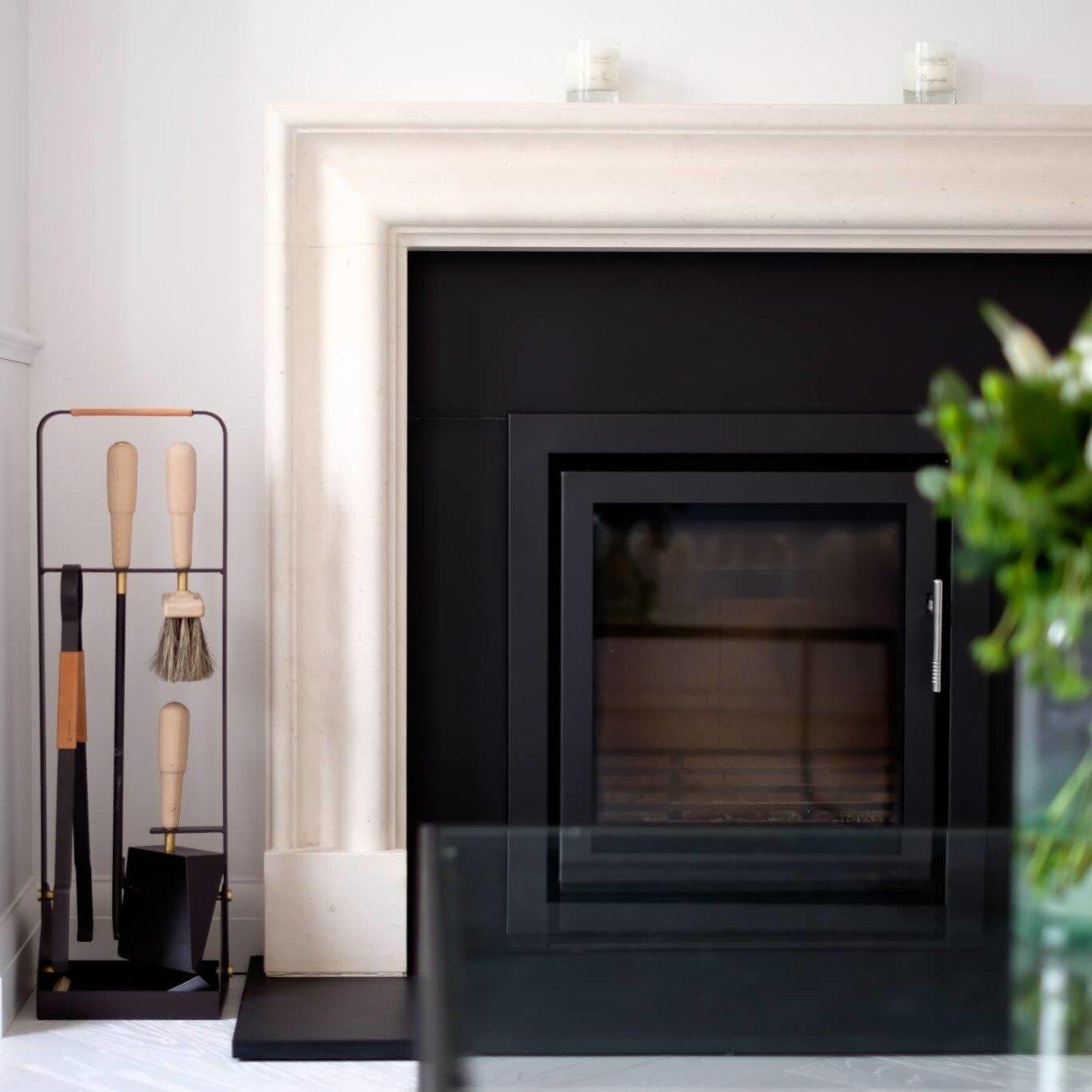 Hampstead Maisonette - bespoke limestone fireplace with wood burner and black slate hearth