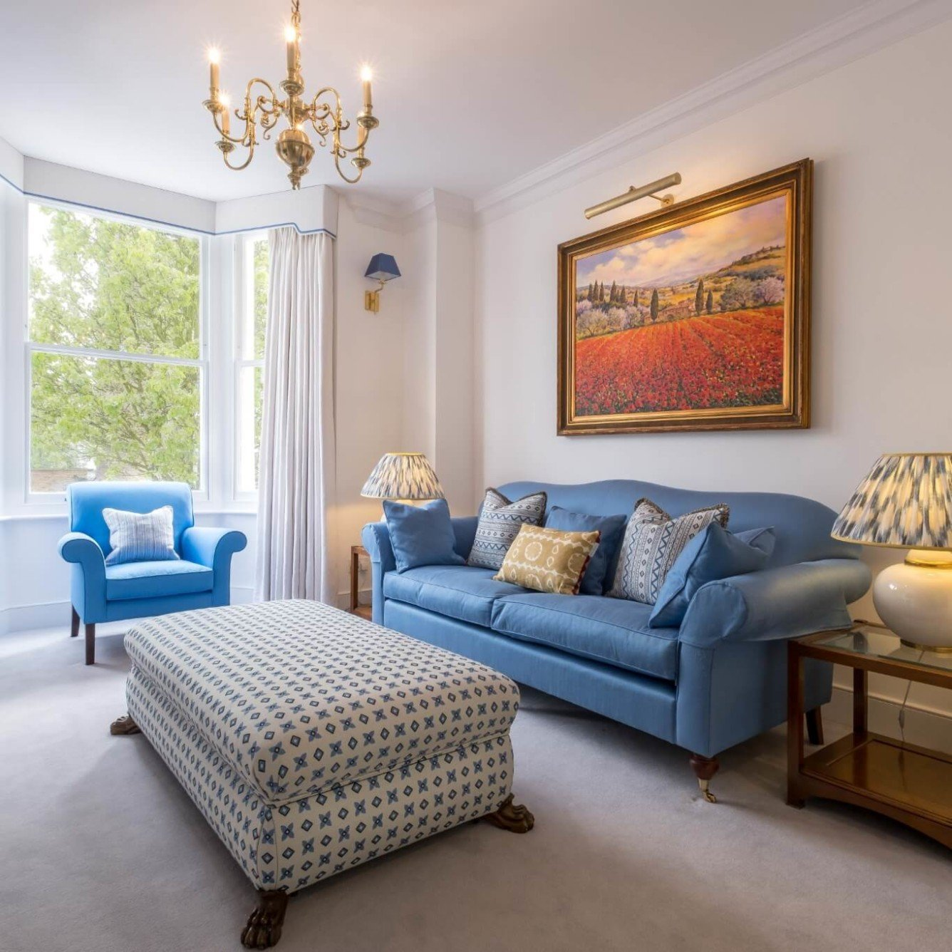 Townhouse in Wandsworth- reception room with blue sofa